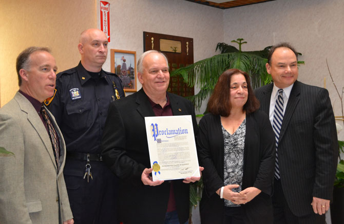 Mayor Allan M. Dorman (center), Village of Islandia, displays the proclamation he received from the Office of Suffolk County Legislator Tom Muratore at the village's 30th anniversary celebration on April 10. Also pictured (left to right): Tom Cilmi, Suffolk County Legislator; Mike Zaleski, Village Trustee; Leslie Kennedy, Suffolk County Legislator, and Robert Martinez, Chief of Staff, Office of Suffolk County Legislator Tom Muratore.