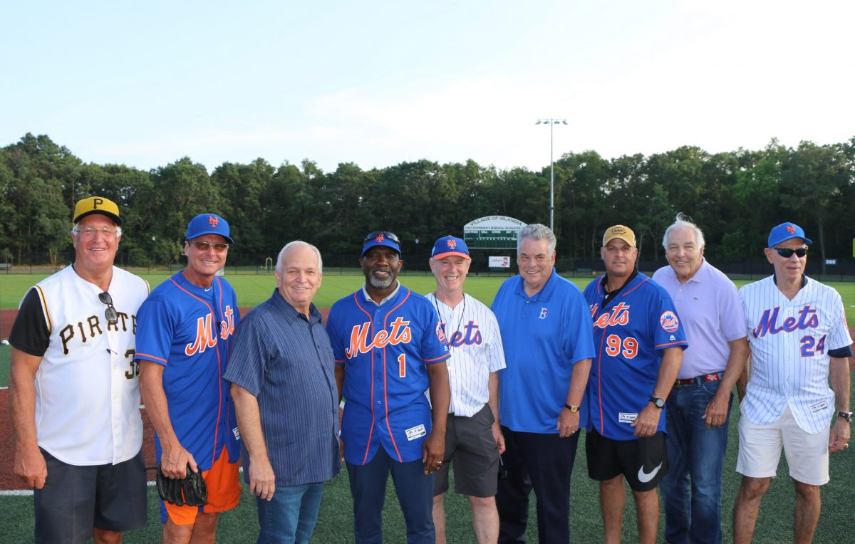 Allan M. Dorman (third from left), Mayor, Village of Islandia, is joined by elected officials, Jake's 58 representatives and former major league players before the start of the 1st Annual Baseball Clinic. Also pictured (left to right) Fred Cambria, former Pittsburgh Pirate; Tim Teufel and Mookie Wilson, former New York Mets; Chuck Kilroy, General Manager, Jake's 58; Peter King, U.S. Congressman; and Turk Wendell, Ed Kranepool and Art Shamsky, former New York Mets.