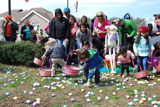Children collect as many Easter eggs as they can during the Village of Islandia's 11th Annual Easter Egg Hunt on March 19.