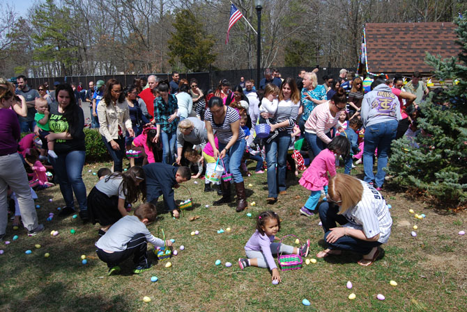 Parents watch their children collect Easter eggs at the Village of Islandia's 9th annual Easter Egg Hunt on April 12.