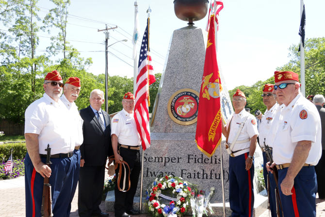 Allan M. Dorman (third from left), Mayor, Village of Islandia, poses with members of the Marine Corps League in front of the replacement United States Marine Corps medallion that was installed in time for the village's annual Memorial Day ceremony, which took place at the Islandia Veterans Memorial Triangle on May 27.