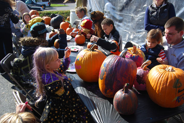 Children and their parents decorate pumpkins during the Village of Islandia's 9th annual Pumpkin Fest on October 26.