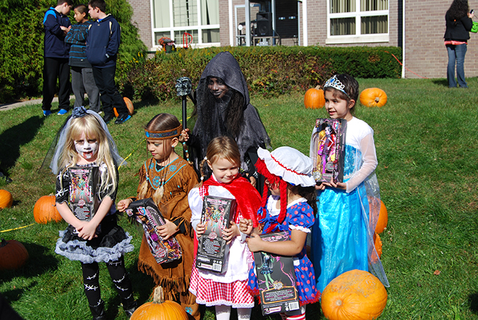 Winners of the girls' Halloween costume contest pose with their prizes at the Village of Islandia's 10th annual Pumpkin Fest on October 25.