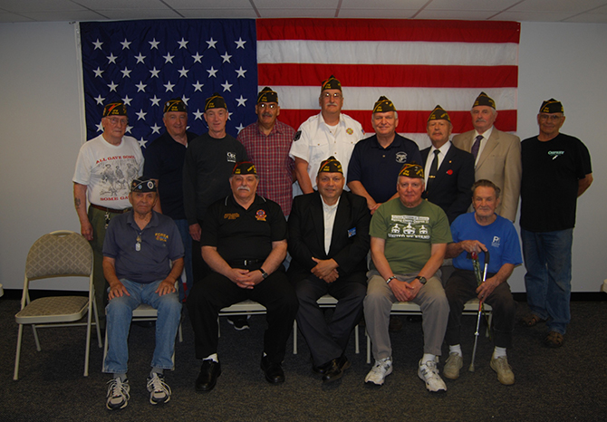 Allan M. Dorman (back row, fourth from right), Mayor, Village of Islandia, is joined by the new officers and members of the Col. Francis S. Midura Veterans of Foreign Wars Post #12144. Pictured (front row, left to right): Aurelio Romeu, Member, VFW Post #12144; Andy Veiga, Junior Vice Commander, Suffolk County Company, Veterans of Foreign Wars and Quartermaster, VFW Post #9486, Lake Ronkonkoma; William Fuchs, Quartermaster, and John Probst, Member, VFW Post #12144. Back row (l-r): Carl Singer, Senior Vice President; Buddy Dekeris, Adjutant; Joel Meyers, Three-Year Trustee; Eusebro Soto, Jr., Member; Raymond Bush, Commander; Raul Jimenez Cintron, Junior Vice President; Tom Brauner, Chaplain; and Gary Ridente, Member, VFW Post #12144.