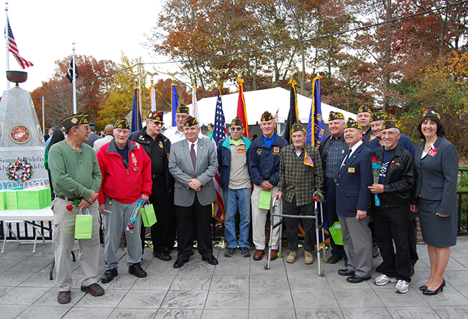 Mayor Allan M. Dorman (fifth from left) is joined the members of the Col. Francis S. Midura Veterans of Foreign Wars Post #12144 at the Village of Islandia's Veterans Day ceremony on November 7.
