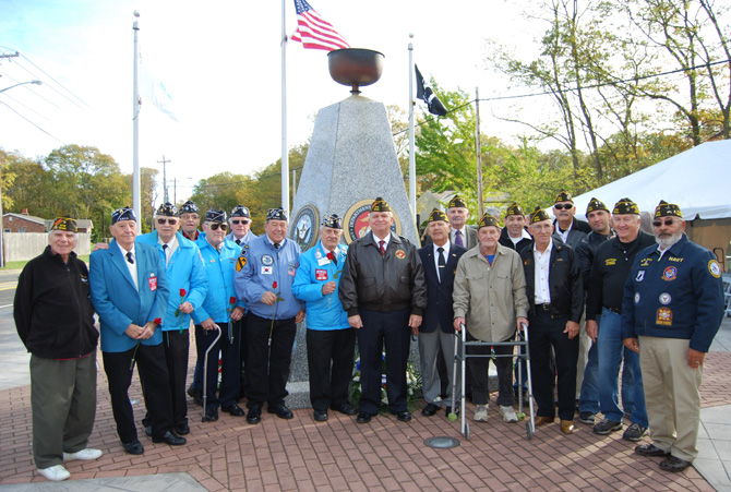 Mayor Allan M. Dorman (center) poses with the members of the Central Long Island Chapter of the Korean War Veterans Association and the Col. Francis S. Midura Veterans of Foreign Wars Post #12144 at the Village of Islandia's Veterans Day ceremony on November 4.