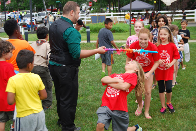 Children take part in a limbo contest during the Village of Islandia's annual Bar-B-Que on July 9.