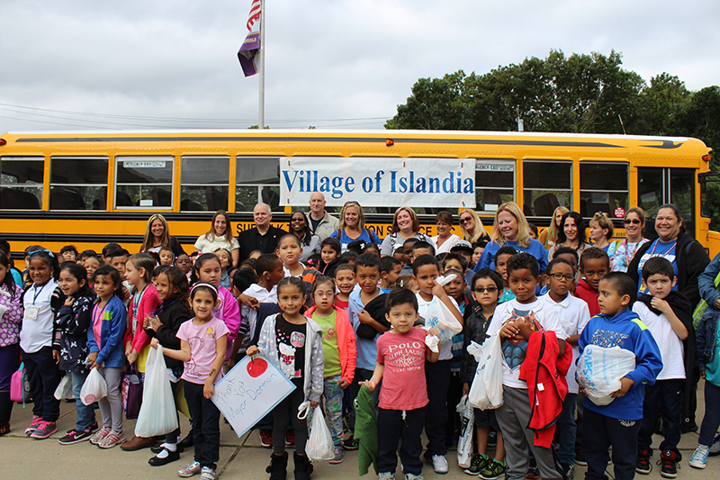 Pictured with the students and teachers at Andrew T. Morrow Elementary School are Denise Schrage (back row, second from left), Activities Director, Village of Islandia, and Mayor Allan M. Dorman (back row, third from left); Dr. Neema Coker (back row, fourth from left), Principal, Andrew T. Morrow Elementary School; and Michael Zaleski (back row, center), Deputy Mayor, before the children leave for their field trip on September 28.