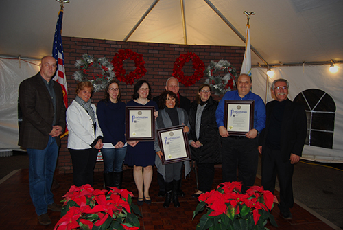 Patricia Ann Kellner (fourth from left), President, The DNA Genealogy Group, Marie Depaula-Walsh (fourth from right) and Robert Sutton (third from right), Volunteer Firefighter, Central Islip Fire Department, were recognized at a Good Neighbor Gala that was held on the grounds of Village Hall on November 30. Also pictured (left to right): Michael Zaleski, Deputy Mayor; Barbara Lacey, Trustee; Denise Schrage, Commissioner, Parks and Recreation; Patty Peters and Burhan Kisla, Trustees, Village of Islandia. Standing behind Ms. Walsh: Allan M. Dorman, Mayor, Village of Islandia.