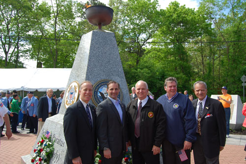 Mayor Allan M. Dorman (center), Village of Islandia, is joined by local elected officials at the village's Memorial Day ceremony at the Veteran's Memorial Triangle on May 24. Also pictured (left to right): Tom Cilmi, Suffolk County Legislator; Anthony Senft, Islip Town Councilman; Al Graf, New York State Assemblyman; and Tom Muratore, Suffolk County Legislator.