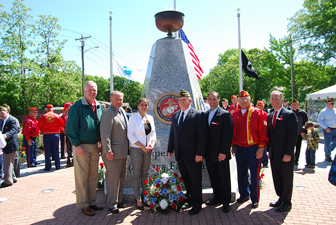 Allan M. Dorman (center), Mayor, Village of Islandia, is joined by (left to right) Michael Fitzpatrick, New York State Assemblyman; John Cochrane, Jr., Councilman, Town of Islip; Monica Martinez, Suffolk County Legislator; Leo Maese, Commandant, Suffolk County Detachment #247 Marine Corps League; and Tom Cilmi, Suffolk County Legislator in front of the Veteran's Memorial Triangle at the village's Memorial Day ceremony on May 23.