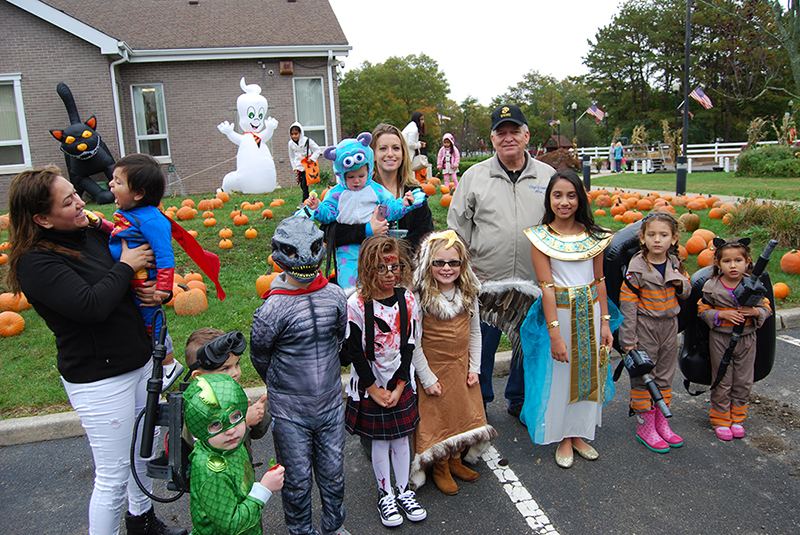 Allan M. Dorman (back row, right), Mayor, Village of Islandia, is joined by the winners of the costume contest at the village's 12th annual Pumpkin Fest on October 22.