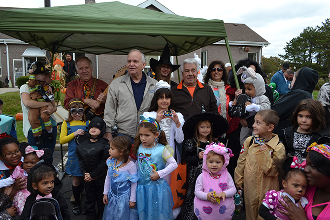 "Allan M. Dorman (back row, center), Mayor, Village of Islandia, is joined by the winners of the costume contest at the village's 11th annual Pumpkin Fest on October 24. Standing with Mayor Dorman are ""Joe the Singing Bus Driver"" (left) and Tony Church (right), Village Administrator."