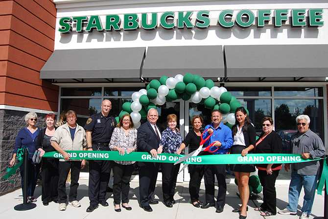 Mayor Allan M. Dorman (sixth from left) and Trustees Mike Zaleski (fourth from left) and Patty Peters (fifth from left), Village of Islandia, and Islandia Village employees join in the ribbon cutting of the new Starbucks at 3701 Expressway Drive North. Also pictured: Deborah Gregorio (fifth from right), Store Manager, Starbucks of Islandia; Jeff Taussig (fourth from right, holding scissors), District Manager and Lindsay Trimarchi (third from right), Real Estate Store Development Manager, New York City Metro Region, Starbucks Coffee Company.