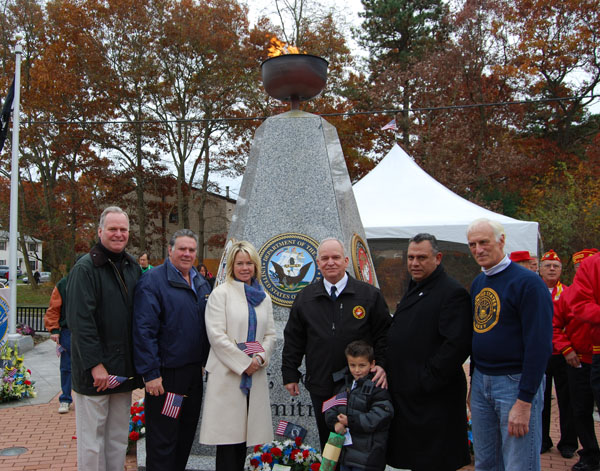 Mayor Allan M. Dorman (third from right) poses with his grandson Collin (front) and local elected officials and war veterans in front of the Islandia Veterans Memorial at the village's Veterans Day ceremony on November 9. Also pictured (left to right): New York State Assemblymen Michael Fitzpatrick and Al Graf, Islip Town Councilwoman Trish Bergin Weichbrodt, Suffolk County District Court Judge Phil Goglas, and William Ferris, Swift Boat veteran.
