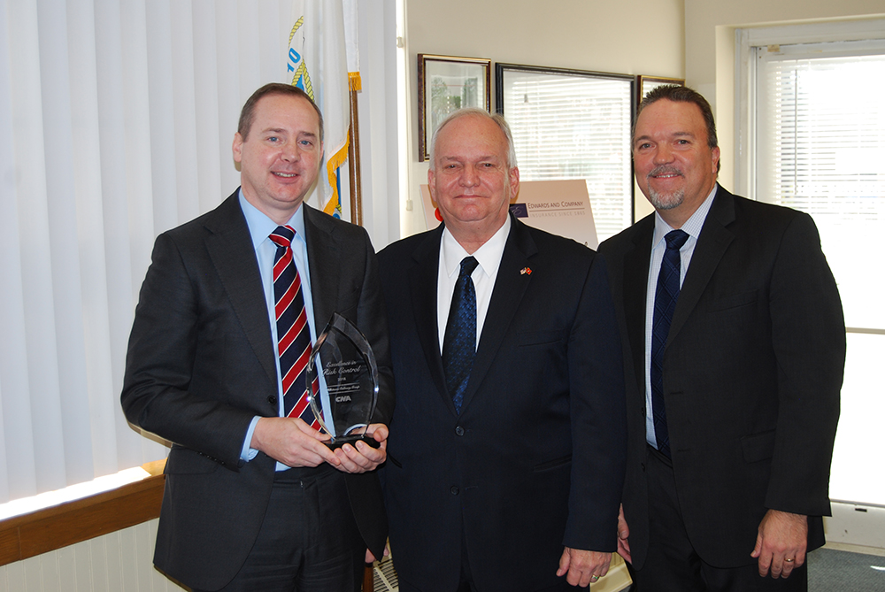 Allan M. Dorman (center), Mayor, Village of Islandia, hosted a special presentation on December 14 for Whitsons Culinary Group, which received the Risk Control Leadership in Safety Award from CNA. He is joined by Barry Street (left), Chief Operating Officer, Whitsons Culinary Group, and Bob Schmid (right), Vice President, Long Island Branch, CNA.