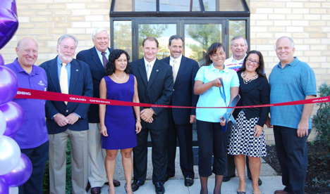 Mayor Allan M. Dorman (right) joins in a ribbon cutting ceremony celebrating the grand opening of Big Brothers Big Sisters of Long Island's new office and Donation Center on Sycamore Avenue.