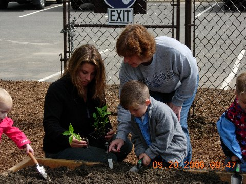 Village residents joined Village officials for the dedication of the Community Victory Garden of Islandia.