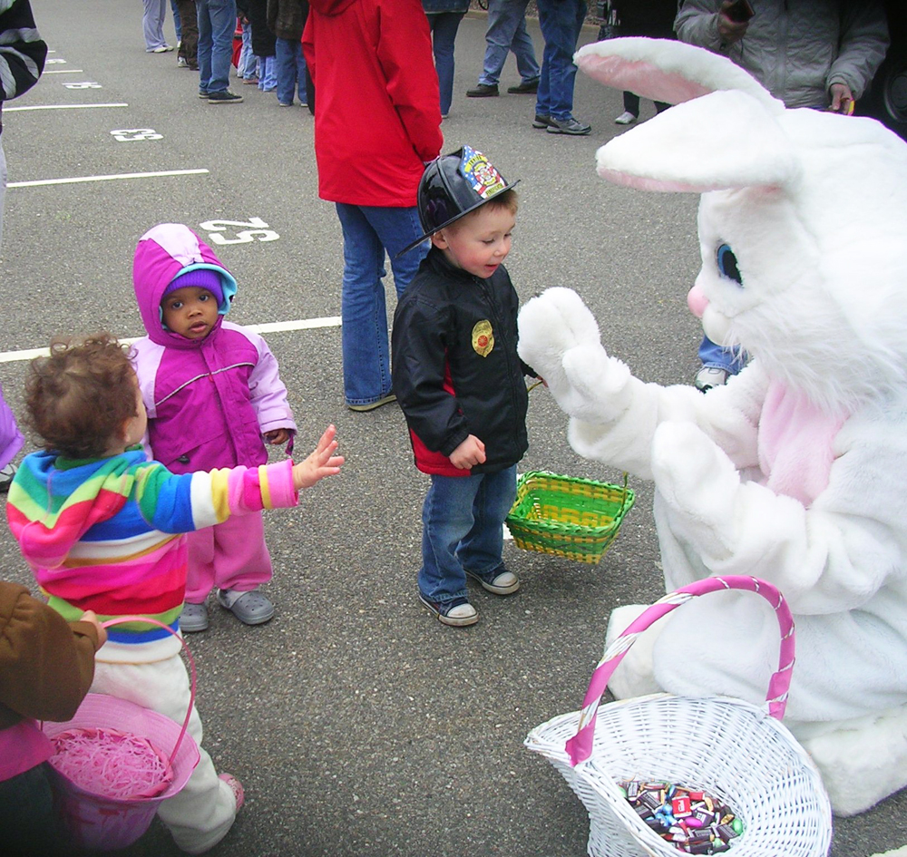 The Easter bunny meets with some of the children at Islandia Village's fourth annual Easter Egg Hunt on April 4.