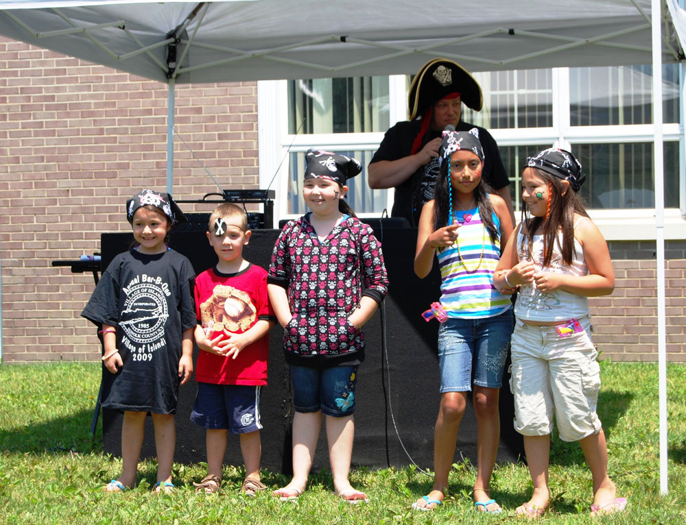 DJ Robert Gerardi (back) with some of the winners of the pirate costume contest.