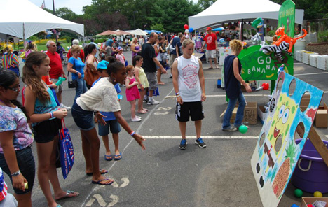 Children take part in some of the games at the Village of Islandia's 7th annual BBQ.