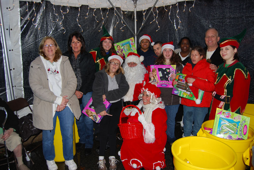 Allan M. Dorman (second from right), Mayor, Islandia Village, joins Santa Claus and participants at the 4th annual Christmas tree lighting.