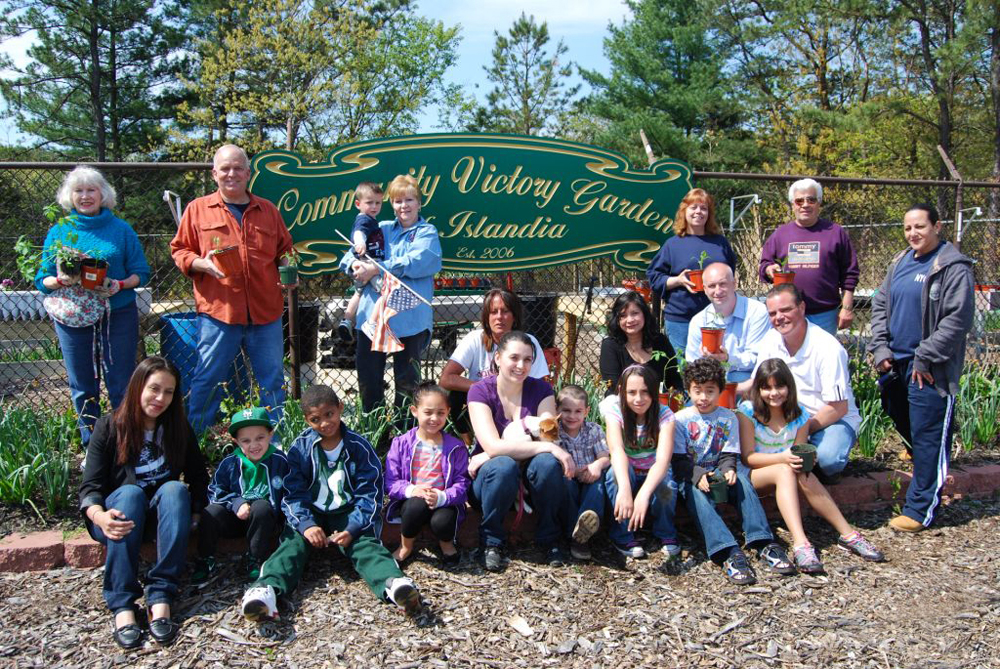 Islandia Village Mayor Allan Dorman (standing, second from left) joins village trustees and local residents in the sixth annual Community Garden Planting on May 7.