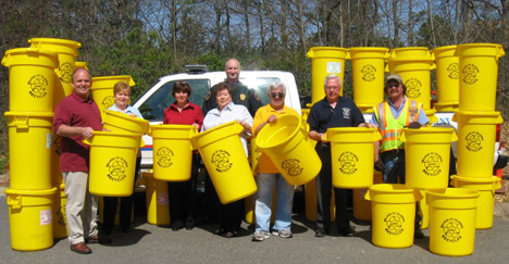 Pictured is Mayor Allan Dorman of the Village of Islandia along with employees who helped to distribute 1600 recycling pails to Village of Islandia residents.