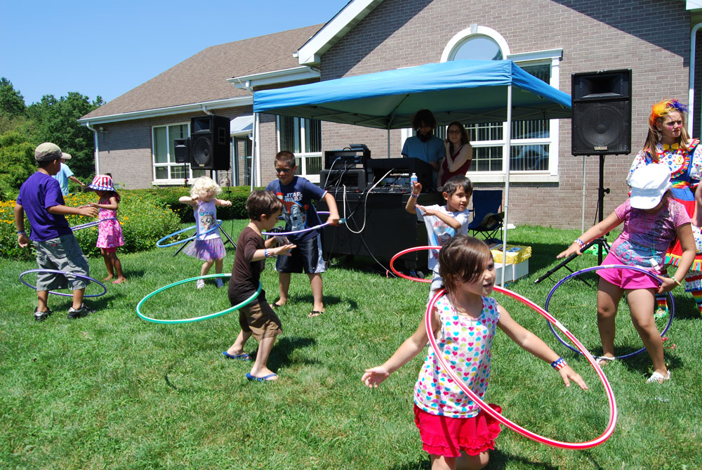 Children take part in the hula hoop contest at the Village of Islandia's 6th annual BBQ.