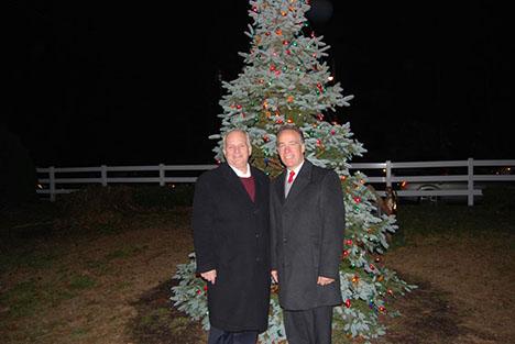 Islandia Village Mayor Allan M. Dorman (left) and Suffolk County Legislator Tom Cilmi (right), who joined Mayor Dorman in the lighting of the tree.