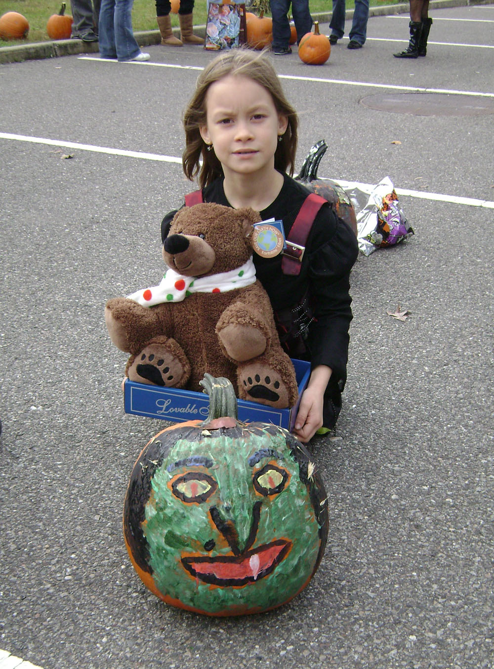 Eight-year-old Niaomi Gatley, winner of the pumpkin coloring contest, poses with her pumpkin and her prize at the Village of Islandia's 5th annual Craft Fair and Pumpkin Fest.