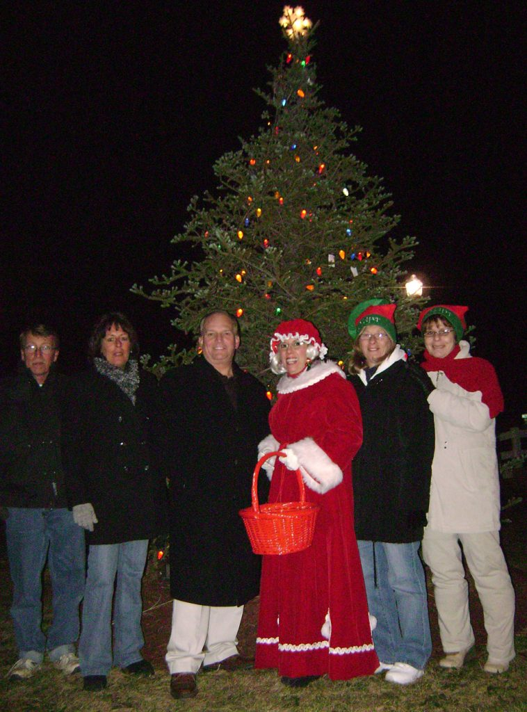 Allan M. Dorman, Mayor, Village of Islandia (third from left) poses with the Islandia Village Board of Trustees at the third annual Christmas tree lighting ceremony, which was held December 6 at Village Hall.