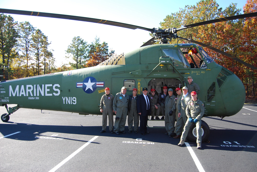 Islandia Village Mayor Allan Dorman (fourth from left) poses with members of Marine Helicopter Squadron 361 Veterans Association, Inc. in front of a Sikorsky UH-34D helicopter that was part of the village's Veterans Day ceremony on November 6.Islandia Village Mayor Allan Dorman (fourth from left) poses with members of Marine Helicopter Squadron 361 Veterans Association, Inc. in front of a Sikorsky UH-34D helicopter that was part of the village's Veterans Day ceremony on November 6.