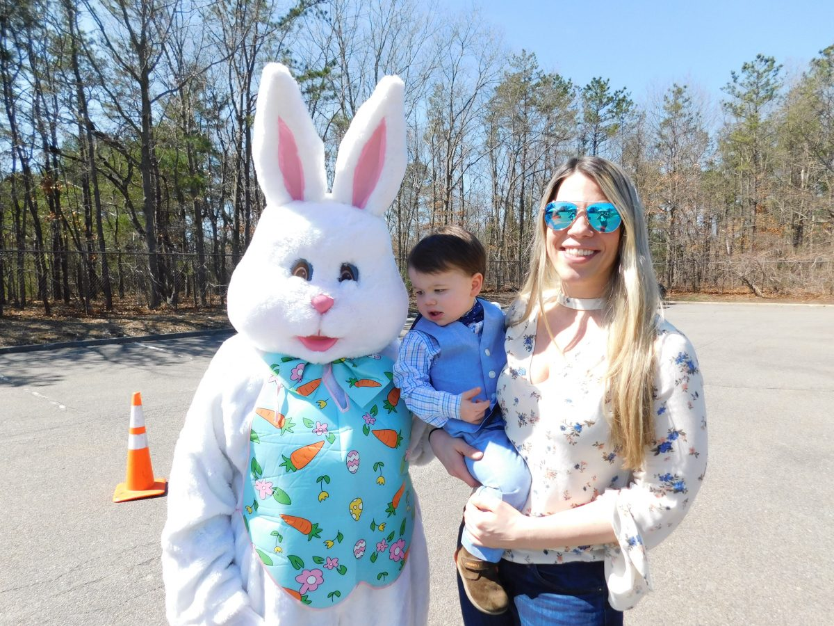 """The Easter Bunny poses with some of the residents who attended the """"Meet the Easter Bunny"""" event at Islandia Village Hall on March 27."""