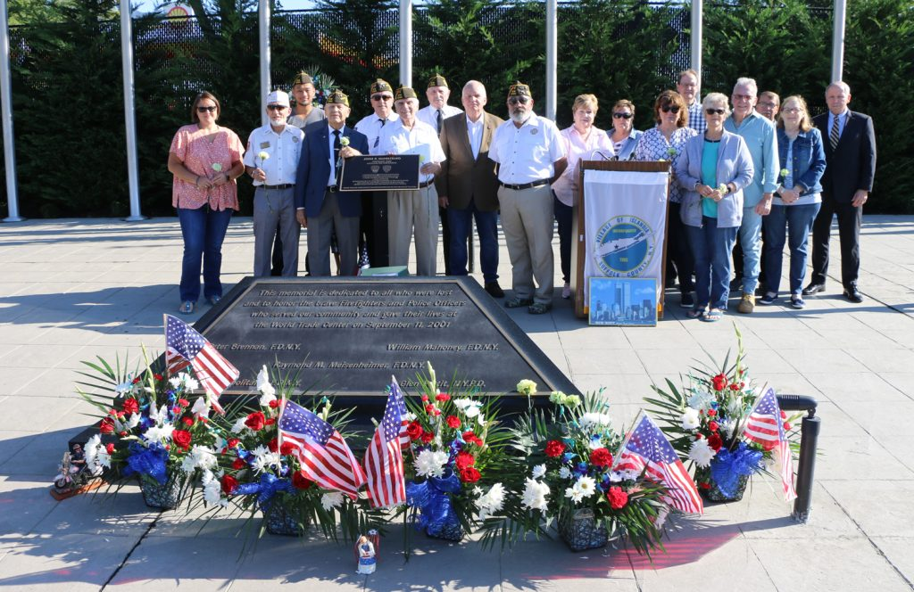 Mayor Allan M. Dorman (front row, fifth from left) poses with village board members, employees and residents and members of the Col. Francis S. Midura Veterans of Foreign Wars Post #12144.