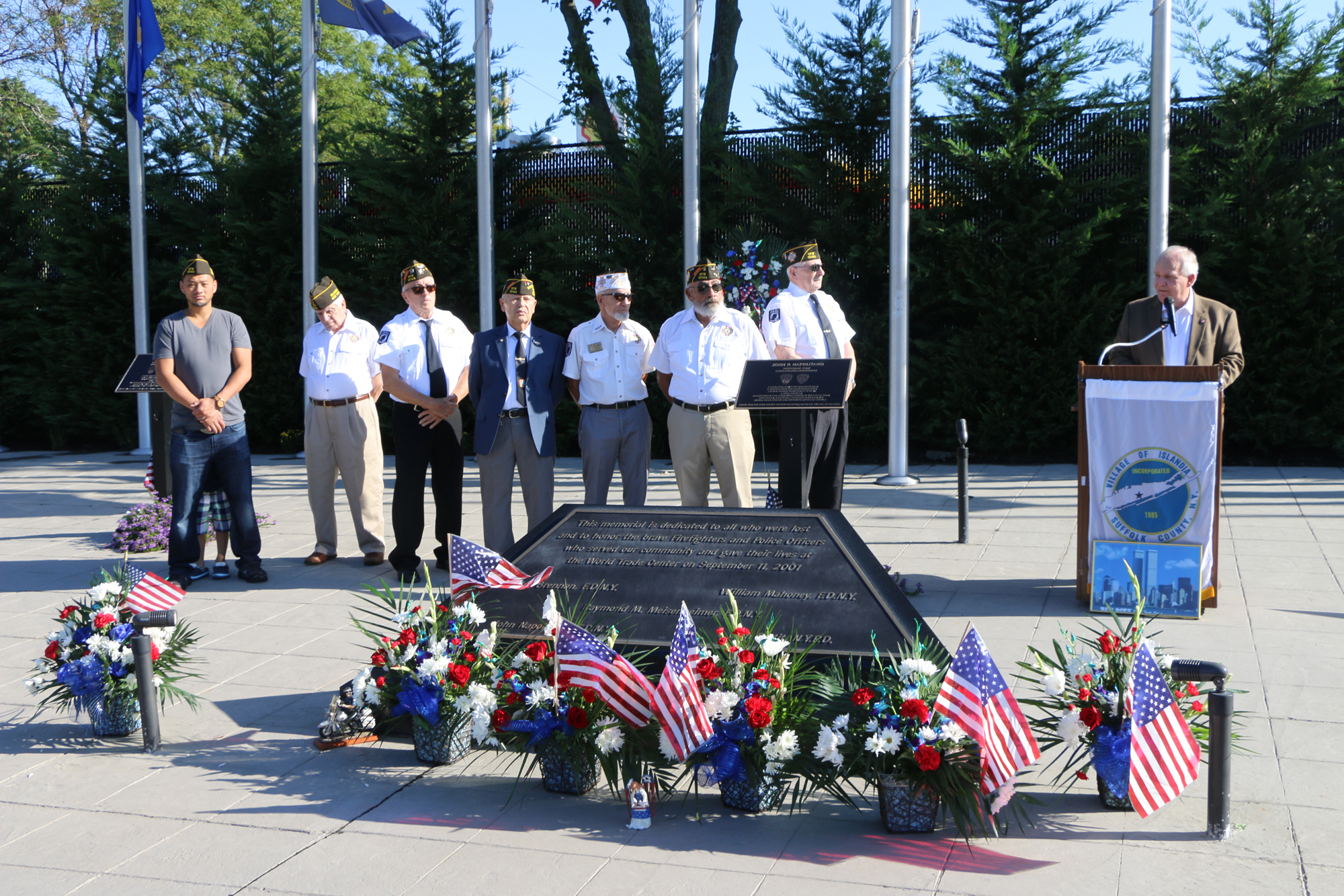 Mayor Dorman (standing behind podium) addresses those in attendance at the September 11th Memorial Ceremony at the First Responders Memorial on September 10.